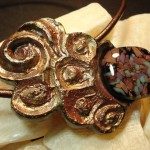 Carved Mayan Wind Necklace by Anne Thornton